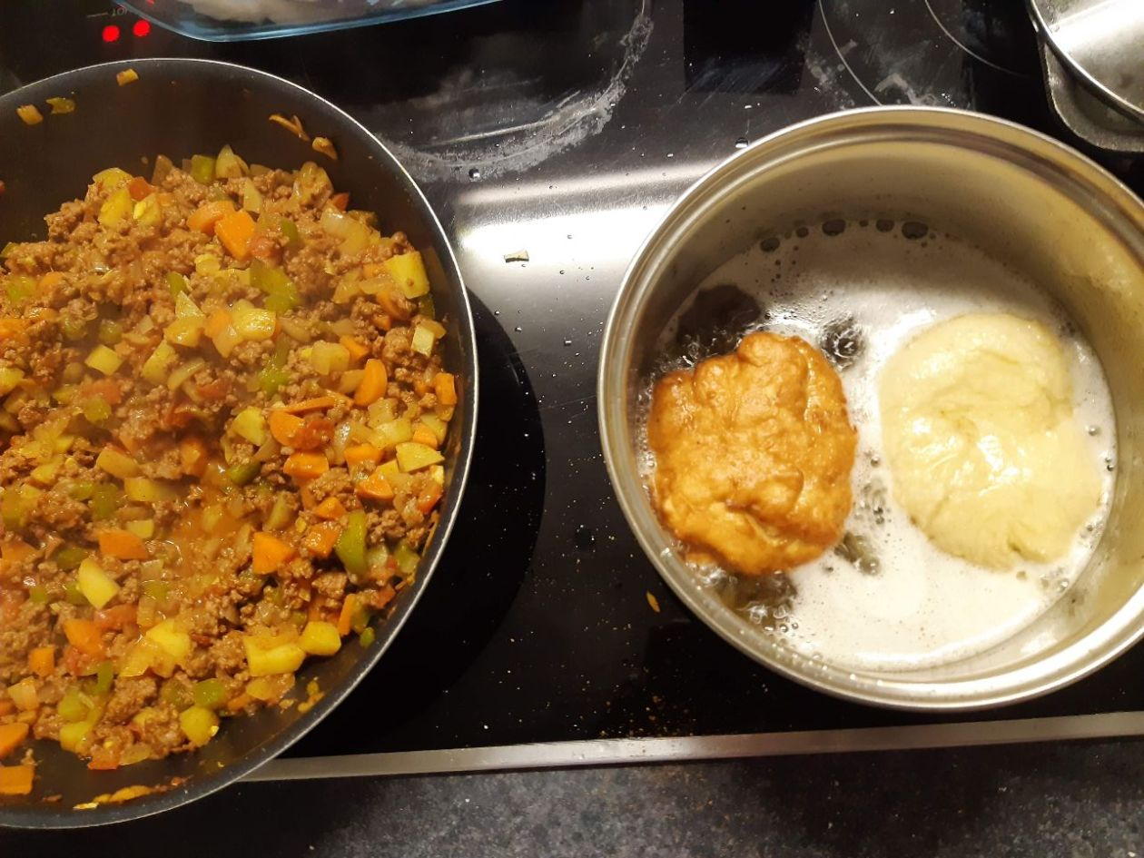 curry mince and vetkoek cooking